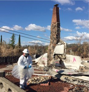 DTSC's Emergency Response Team identifies and safely removes household hazardous waste after the Cherokee and LaPorte fires in Butte County. Pink spray paint indicates suspected asbestos-containing material.