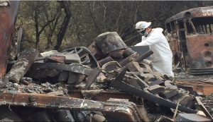 A DTSC contractor sorts through debris in the wake of he Lobo Fire in Nevada County.