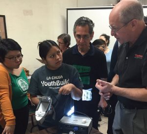 Steven Gendel with ThermoFisher Scientific explains X R F technology to a student.
