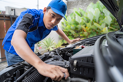 Mechanic doing some inspection on car's engine